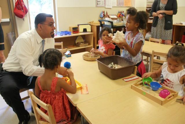 U.S. Secretary of Education John B. King Jr. talks to children at Edna Oliver Early Learning Cente